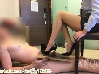 Lesbian slave licks feet and shoes